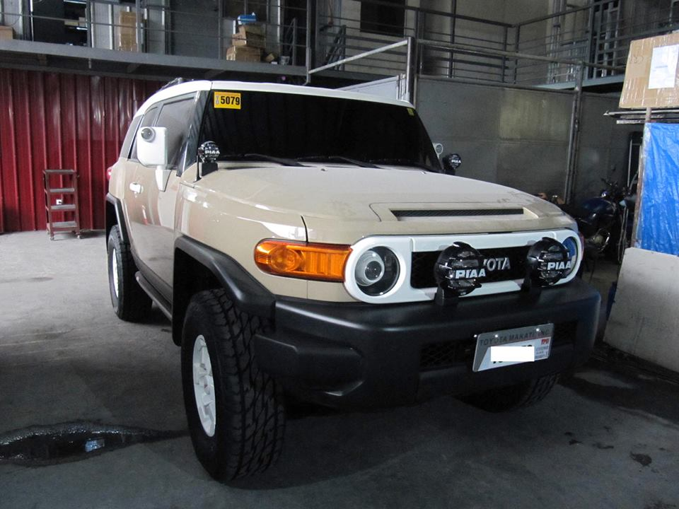 Hid retrofit toyota fj cruiser a pop up plate holder if the owner decides to use the light bar if not it is neatly tucked in behind the plates lighting creativity is in our blood mozeypictures Images