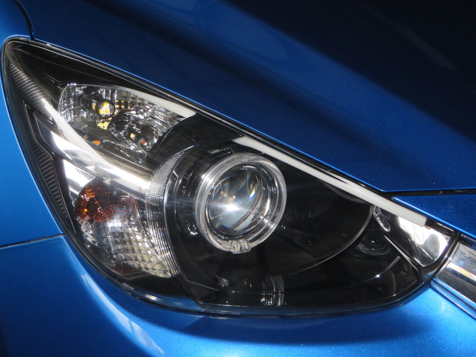 HID Retrofit » Mazda2